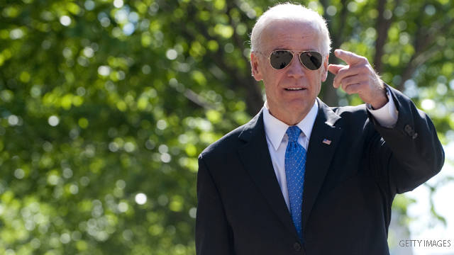 US Vice President Joe Biden walks to a meeting of bipartisan members of Congress to begin work on a legislative framework for comprehensive deficit reduction at Blair House, across the street from the White House in Washington, DC, May 5, 2011. AFP PHOTO / Saul LOEB (Photo credit should read SAUL LOEB/AFP/Getty Images)