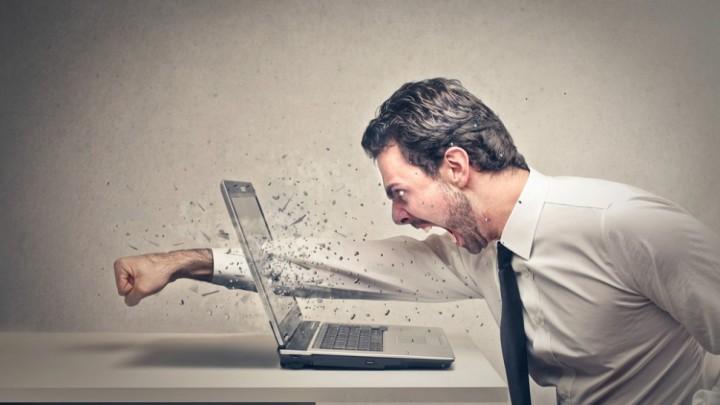 Man punching computer