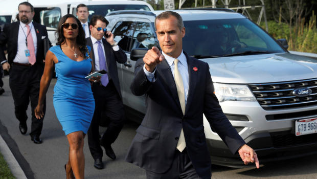 Former campaign manager Corey Lewandowski (C) says hello to reporters as he and White House advisors Sebastian Gorka (from L), Omarosa Manigault and Communications Director Anthony Scaramucci accompany President Trump for an event celebrating veterans at AMVETS Post 44 in Struthers, Ohio, U.S. July 25, 2017. REUTERS/Jonathan Ernst