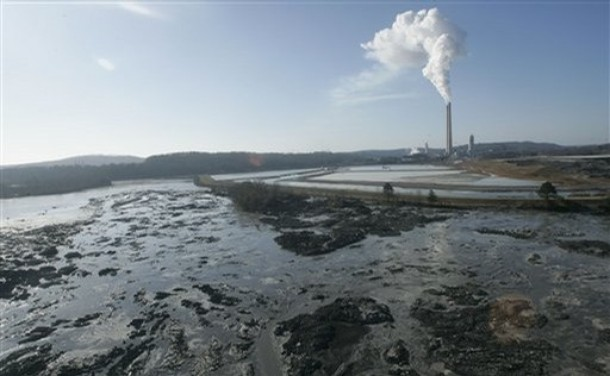 An aerial view shows the aftermath of a retention pond wall collapse at the Tennessee Valley Authorities Kingston Fossil Plant, Monday, Dec. 22, 2008 in Harriman, Tenn. The Tennessee Valley Authority says the 40-acre pond held a slurry of ash generated by the coal-burning Kingston Steam Plant. (AP Photo/Wade Payne)